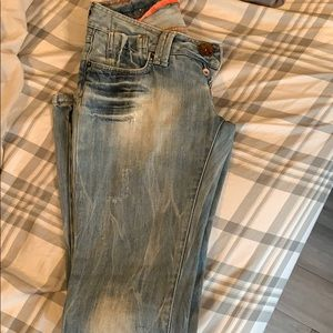 Distressed bell bottom jeans. Gently worn